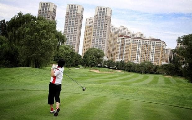 A-golfer-tees-off-at-Huatang-International-Golf-Club-in-Beijing-PhotoAlamy-large_trans_NvBQzQNjv4BqpJliwavx4coWFCaEkEsb3kvxIt-lGGWCWqwLa_RXJU8