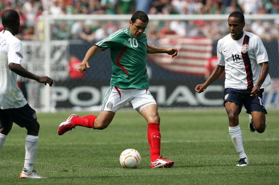 75388212-cuauhtemoc-blanco-of-mexico-moves-the-ball-against-the_crop_exact