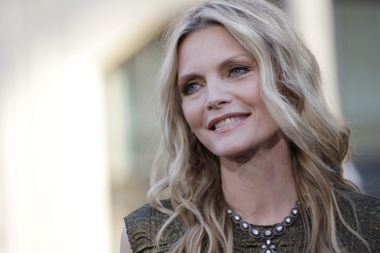 """Pfeiffer poses at the premiere of the film """"Dark Shadows"""" at the Grauman's Chinese theatre in Hollywood"""